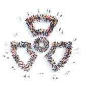 Lidé ve formě záření znamení. — Stock fotografie