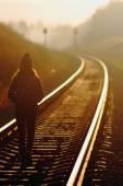 Girl goes on rails — Stock Photo