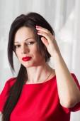 Beautiful girl in red — Stock Photo