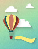 Flat air balloon in clouds with ribbon — Stock Vector