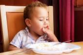 Kid eats. — Stock Photo