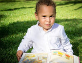 A little Boy with a book. — Stock Photo