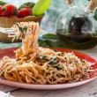Pasta with fish and creamy spinach sauce — Stock Photo #71332393