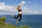 Beautiful girl jumping — Stock Photo