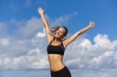 Beautiful girl  with arms outstretched — Stock Photo