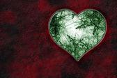 Coração com decoração verde dentro — Fotografia Stock