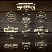 Swimming badges logos and labels for any use — Stock Vector