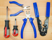 A tongs, pliers, Crimping pliers and two screwdrivers — Stock Photo
