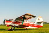 Light aircraft on a green field. — Stock Photo