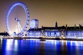 London Eye at night along the South Bank of River Thames — Stock Photo