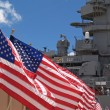 US Flags Flying Beside the Battleship Missouri Memorial, with Four Sailors — Stock Photo #52690865