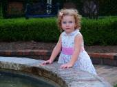 Girl Caught Playing in the Fountain — Stock Photo