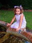 Young Girl Playing in Fountain — Stock Photo