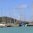 Wind surfer sailing in Falmouth Harbour Marina in Antigua Barbuda in the Caribbean Lesser Antilles West Indies. — Stock Photo #55336235