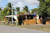 Typical colorful roadside fruit and craft stand or market in Antigua Barbuda Lesser Antilles, West Indies, Caribbean. — Stock Photo