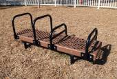 Brown and black bench dip exercise equipment in a park — Stock Photo