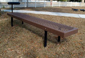 Brown and black curling bench exercise equipment in a park. — Stock Photo