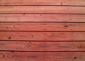 Wooden slats on a weathered wooden deck with redwood stain. — Stock Photo