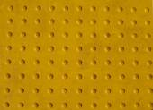 Grunge Yellow Texture of a Non-slip Pattern on a Sidewalk — Stock Photo