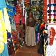 Постер, плакат: Shop Owner in the Antiguan Barbuda Marketplace