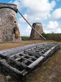 Old windmills behind paddles on Bettys Hope Plantation near Seatons, Pares on Antigua Barbuda in the Caribbean Lesser Antilles West Indies. — Stock Photo