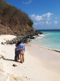 Couple standing on Frys beach on Antigua Barbuda in the Caribbean Lesser Antilles West Indies. — Stock Photo