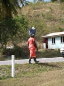 Woman in Antigua Barbuda Carrying Bundle on Her Head — Stock Photo