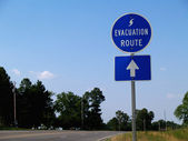 Blue hurricane evacuation route sign along a highway. — Stock Photo
