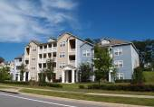 Three story condos, apartments or townhomes with vinyl siding of blue and tan. — Stock Photo