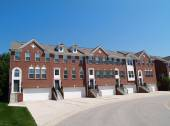 Red brick condos or town homes with the garage in the front. — Stock Photo