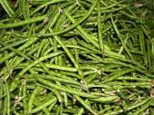 Large pile of unshelled peas in green pods. — Stock Photo