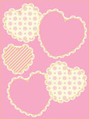 Five different vector hearts with Victorian eyelet trim in shades of pink, gold and ecru with copy space. — Vector de stock