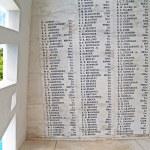 Постер, плакат: Names on the wall of the USS Arizona Memorial beside a unique window at Pearl Harbor in Honolulu Hawaii