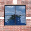 Four paned window on a red brick wall with special brickwork around it. — Stock Photo #56963409