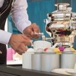 Waiter serving tea — Stock Photo #61862909