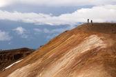 Couple taking photos in Krafla volcano slope — Stock Photo
