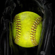 Old softball in a glove — Stock Photo #67437193
