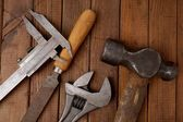 Hammer, caliper, file and wrench  Old tools — Stock Photo