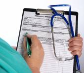 Doctor with medical chart and stethoscope — Foto de Stock
