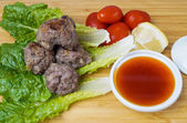 Asian meatballs with sauce — Stock Photo