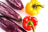 Striped eggplant and bell peppers — Stock Photo