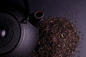 Black Teapot with Healthy Tea Leaves — Stock Photo