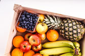 Wood Crate filled with Organic ripe fruit — Stock Photo