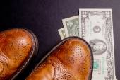 Dollars under a pair of Shoes — Stock Photo