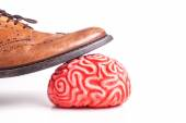 Human brain under a business man feet — Stock Photo