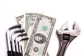 Work tools lying with Money — Stock Photo