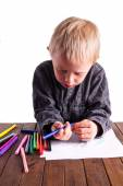Little boy draws a drawing — Stock Photo