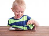 Boy sitting with Digital Tablet — Stock Photo