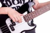 Hands of an teenager plays guitar — Stock Photo