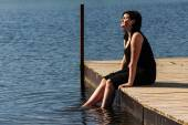 Young lady sitting on the jetty  — Stock fotografie